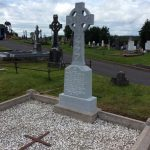 Headstone and grave after cleaning has been carried out.